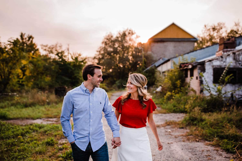 couple walk through abandoned industrial buildings - merrickville engagement - carley teresa photography