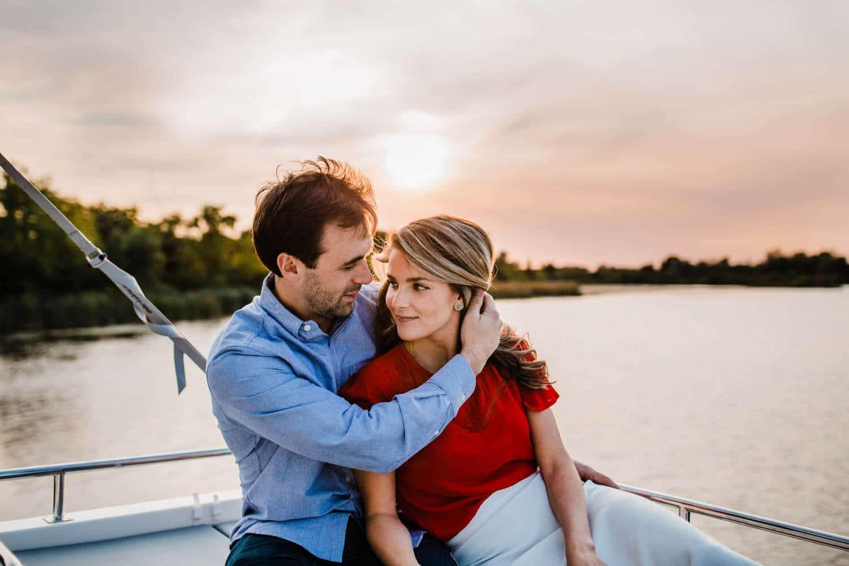 couple take in sunset on boat - merrickville engagement - carley teresa photography