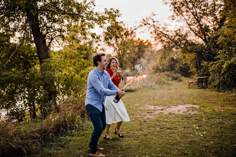 couple pop champagne - merrickville engagement - carley teresa photography
