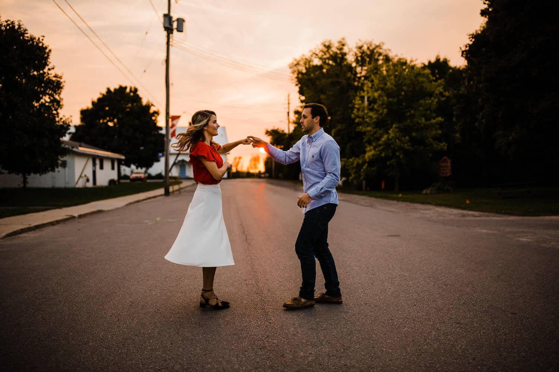 couple dance in street during sunset - merrickville engagement - carley teresa photography