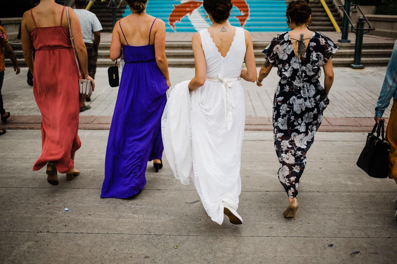 bride and her girlfriends walk through the city - ottawa wedding photographer - carley teresa photography