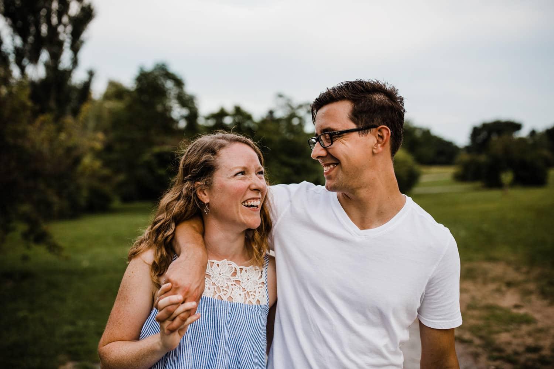couple laugh together outside - ottawa wedding photographer - carley teresa photography