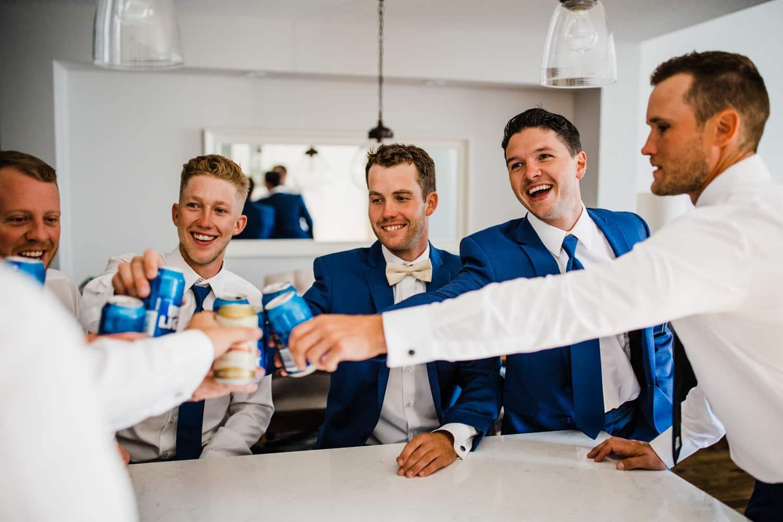 groom and groomsmen enjoy a pint - ottawa wedding photographer - carley teresa photography