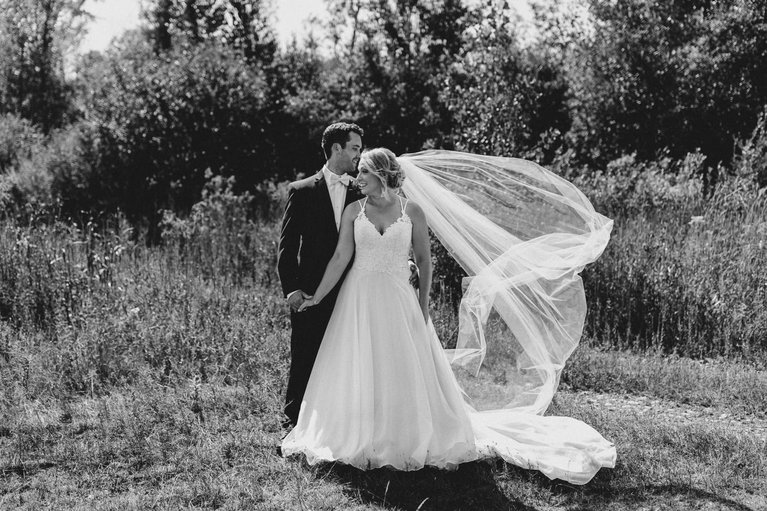 brides cathedral veil blows in wind - ottawa wedding photographer - carley teresa photography