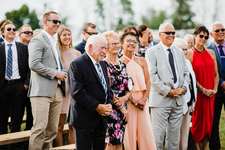 family reacts during wedding ceremony - ottawa wedding photographer - carley teresa photography