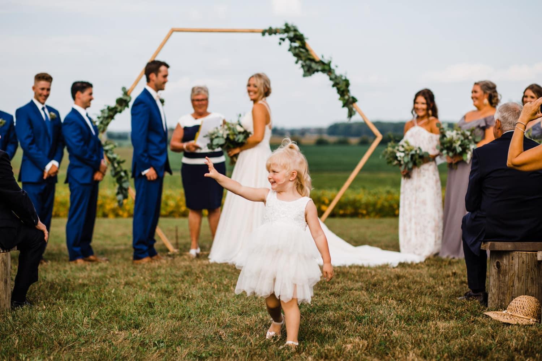 flower girl mingles during ceremony - ottawa wedding photographer - carley teresa photography