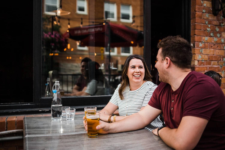 couple enjoy patio drinks - ottawa wedding photographer - carley teresa photography