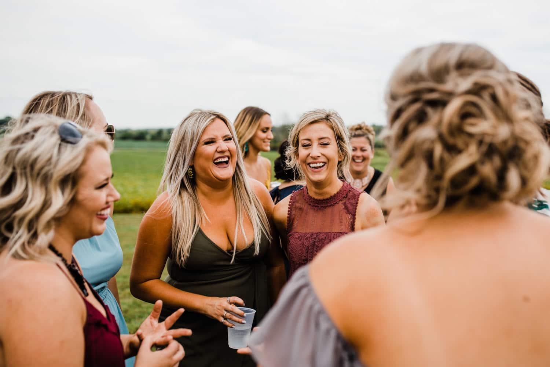 guests laugh at outdoor wedding - ottawa wedding photographer - carley teresa photography