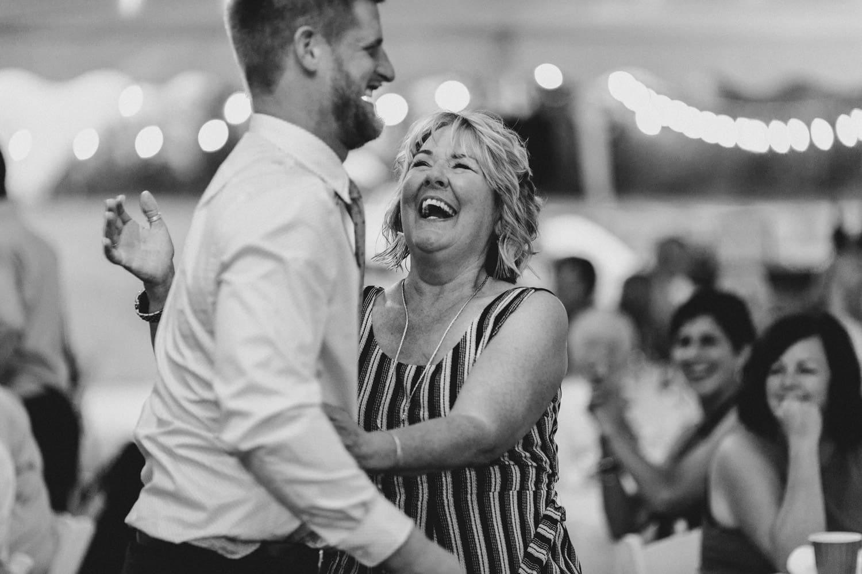 guests laugh at wedding reception - ottawa wedding photographer - carley teresa photography