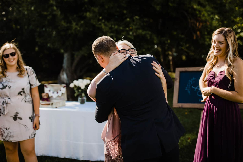 groom hugs mother in law - ottawa wedding photographer - carley teresa photography