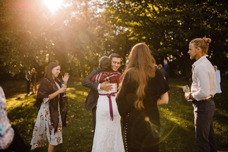 bride hugs guests during wedding reception - ottawa wedding photographer - carley teresa photography