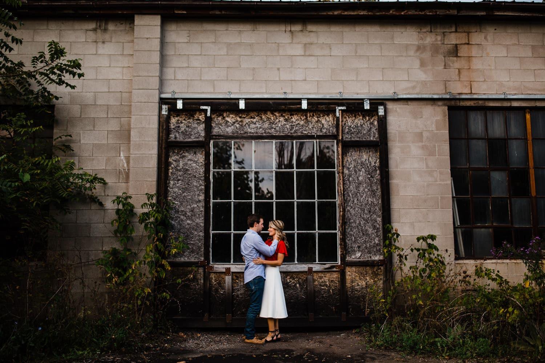 couple stand in abandoned industrial area - ottawa wedding photographer - carley teresa photography