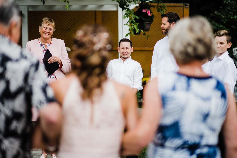 groom sees his bride walking down aisle - ottawa wedding photographer - carley teresa photography