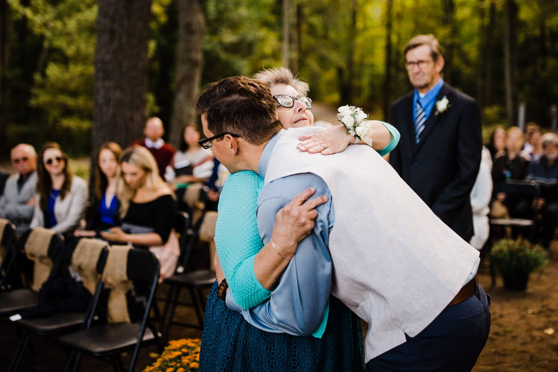 groom hugs his mom during wedding ceremony - ottawa wedding photographer - carley teresa photography