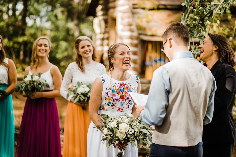 bride laughs during wedding vows - ottawa wedding photographer - carley teresa photography