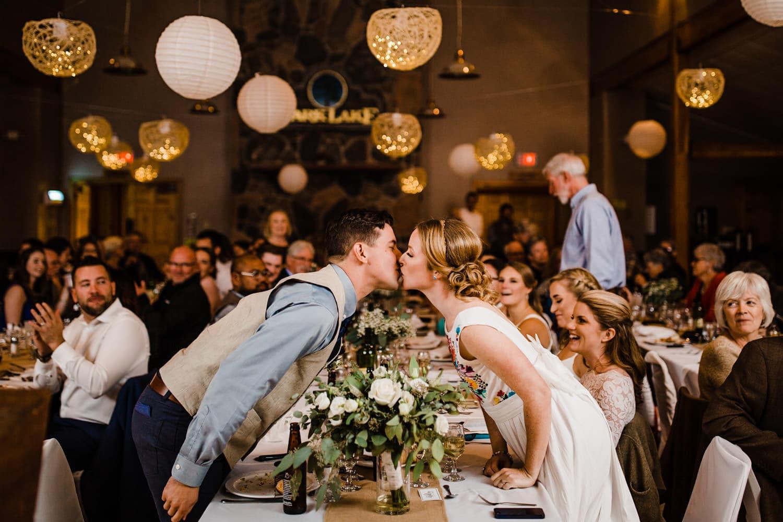bride and groom kiss during reception - ottawa wedding photographer - carley teresa photography