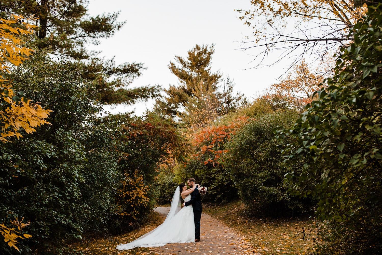bride and groom embrace along pathway - ottawa wedding photographer - carley teresa photography