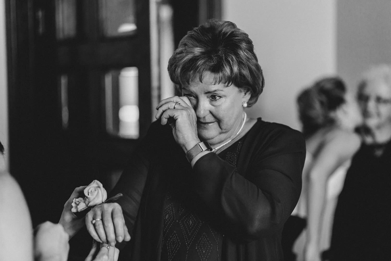 mother of the groom wipes a tear - ottawa wedding photographer - carley teresa photography