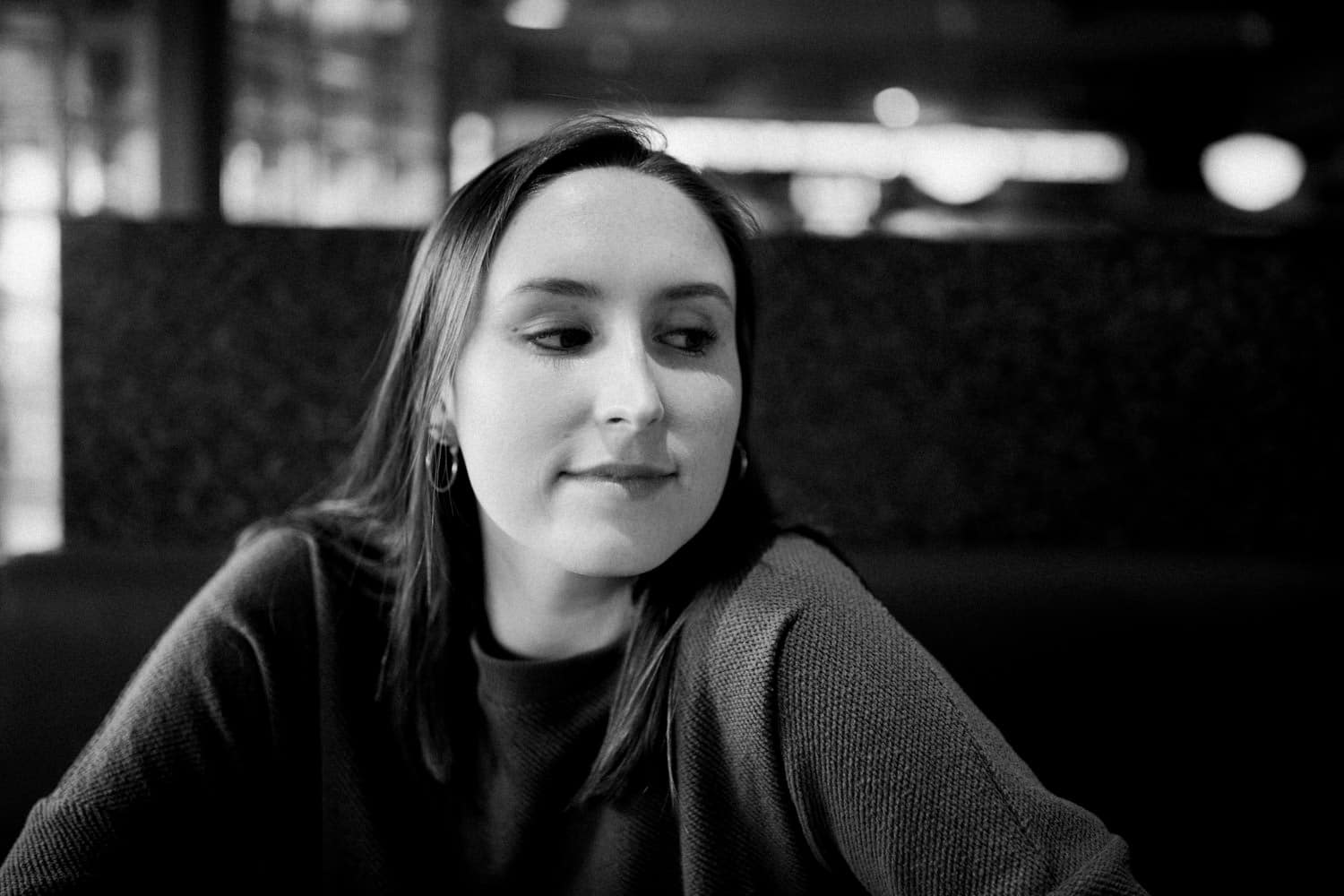 black and white portrait of a woman in a diner