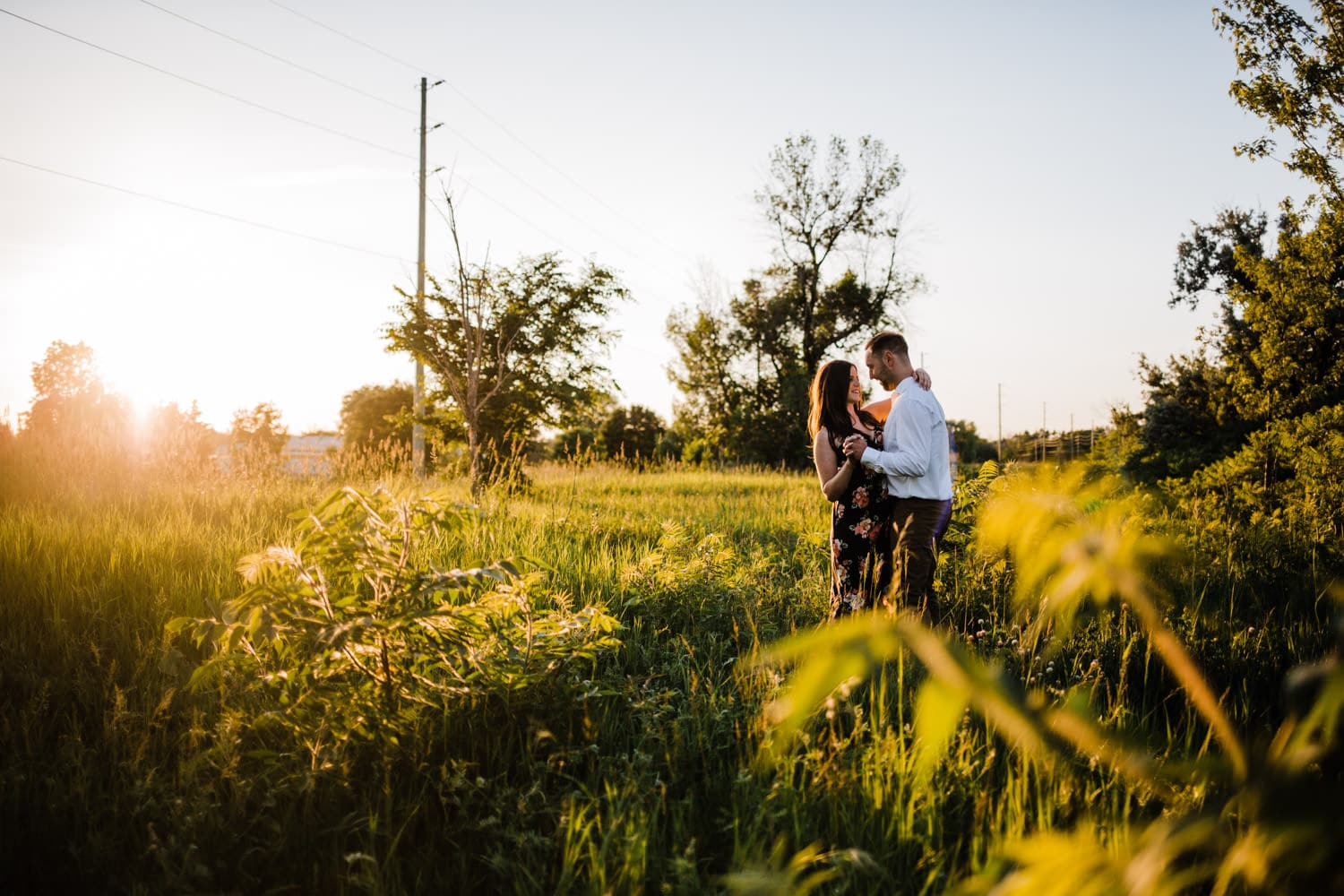 couple dance in tall grass - ottawa golden hour engagement session