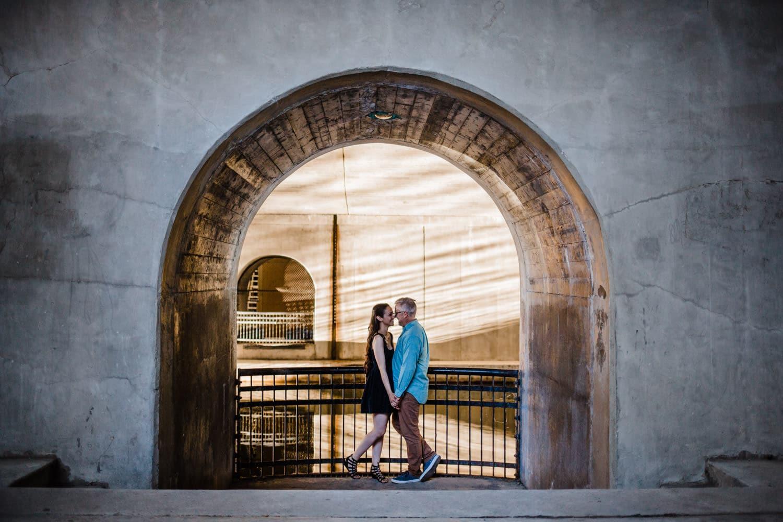 couple stand at ottawa locks - ottawa golden hour engagement session