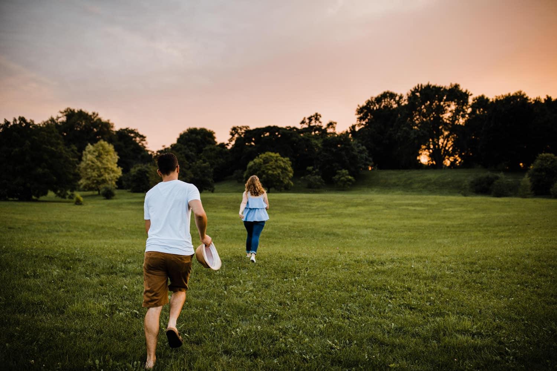 couple run around arboretum grounds - ottawa golden hour engagement session