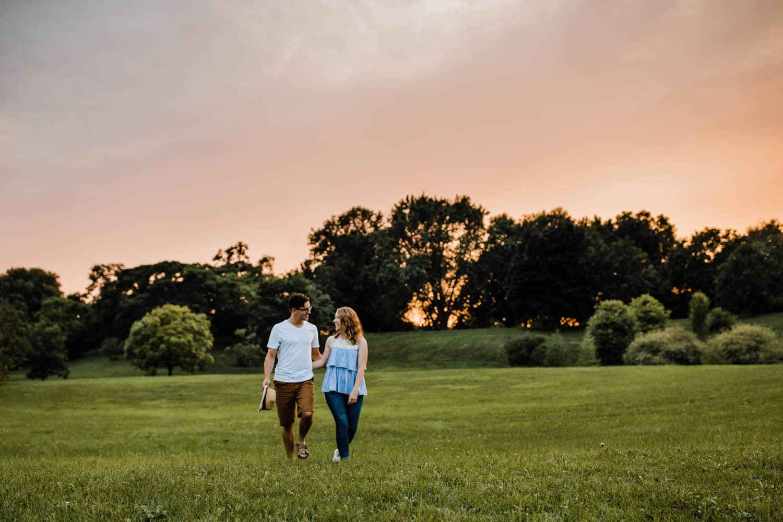couple walk across arboretum property - ottawa golden hour engagement session