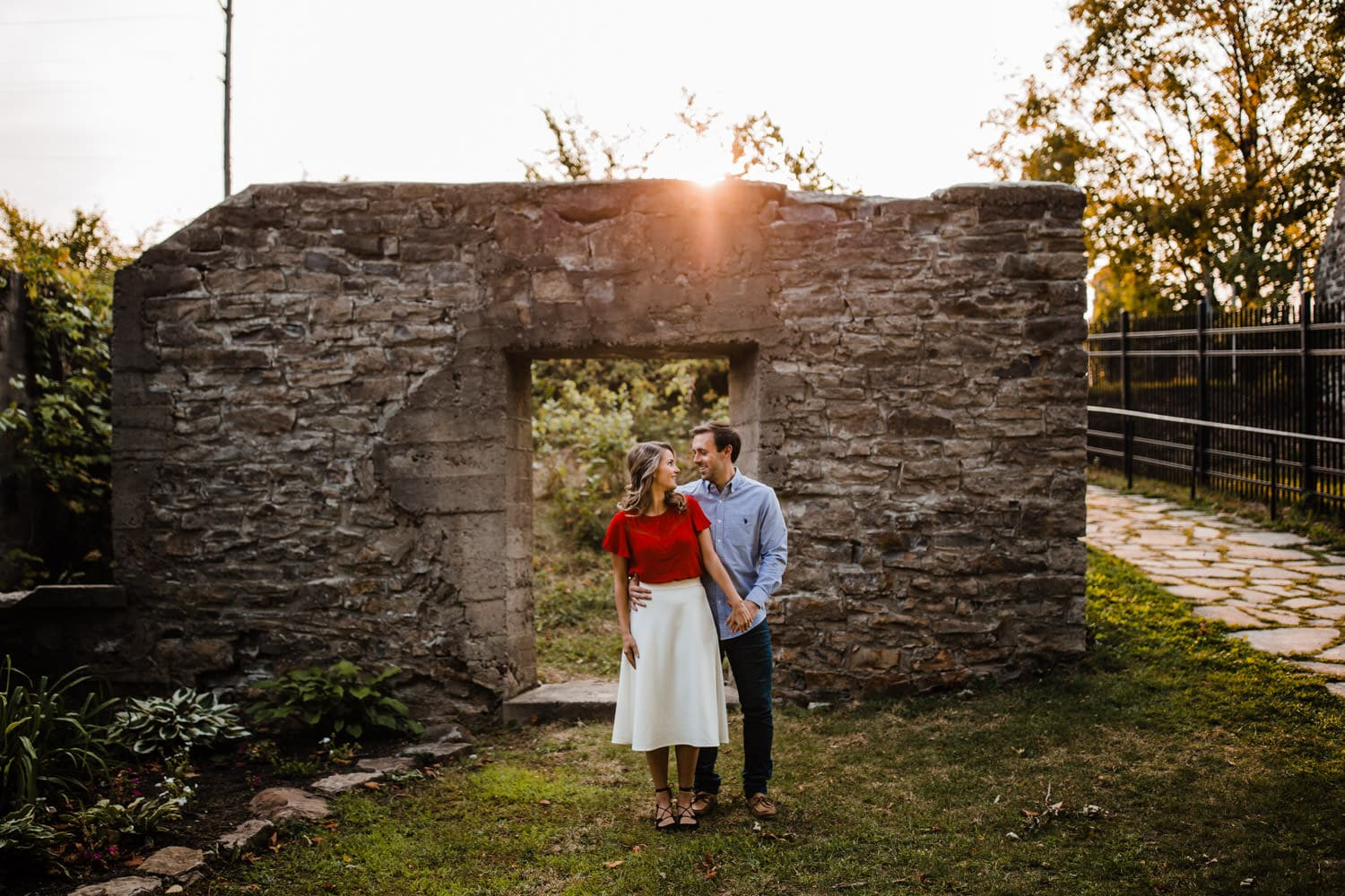 couple stand in front of old ruins - ottawa golden hour engagement session