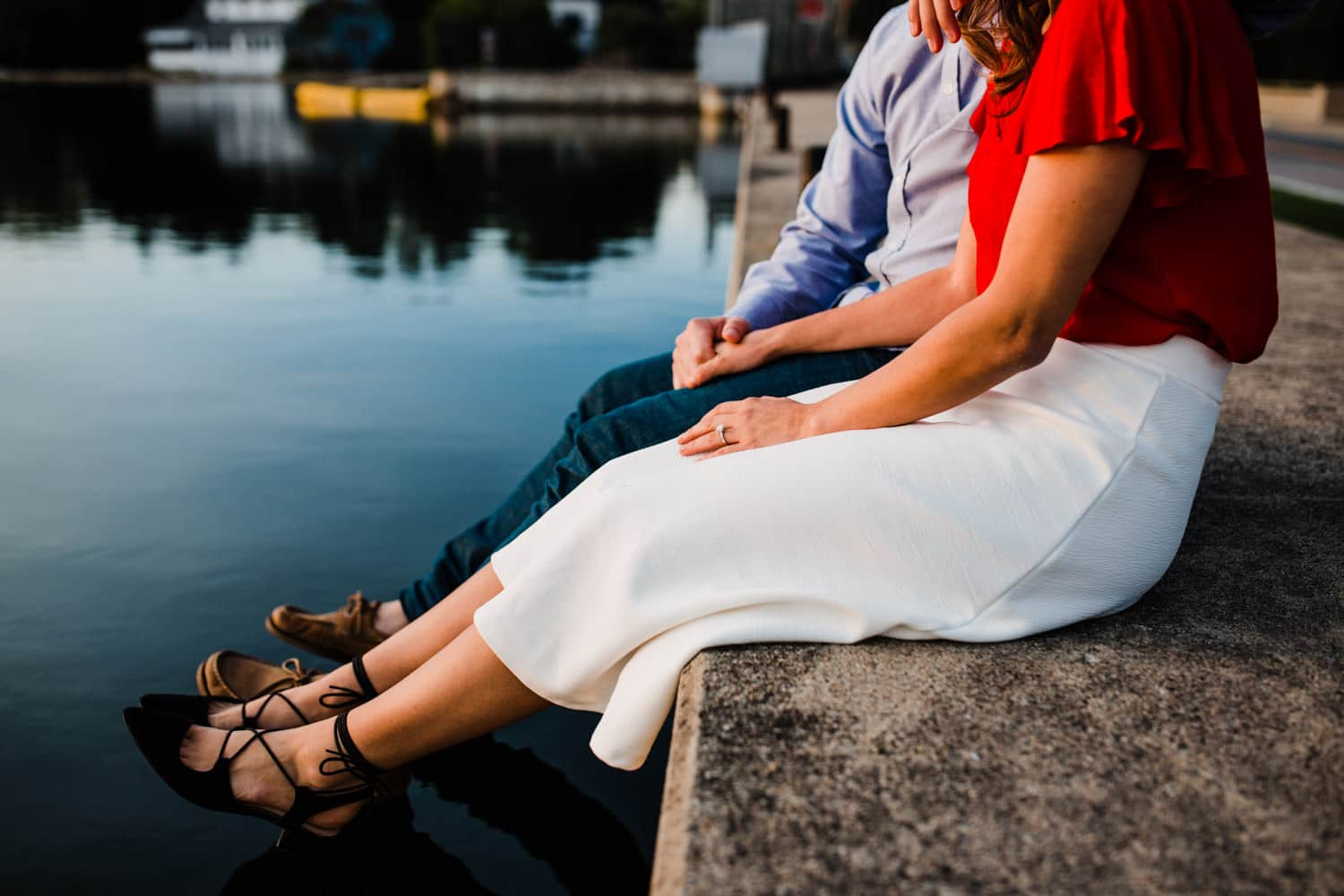 couple watch sunset by the water - ottawa golden hour engagement session