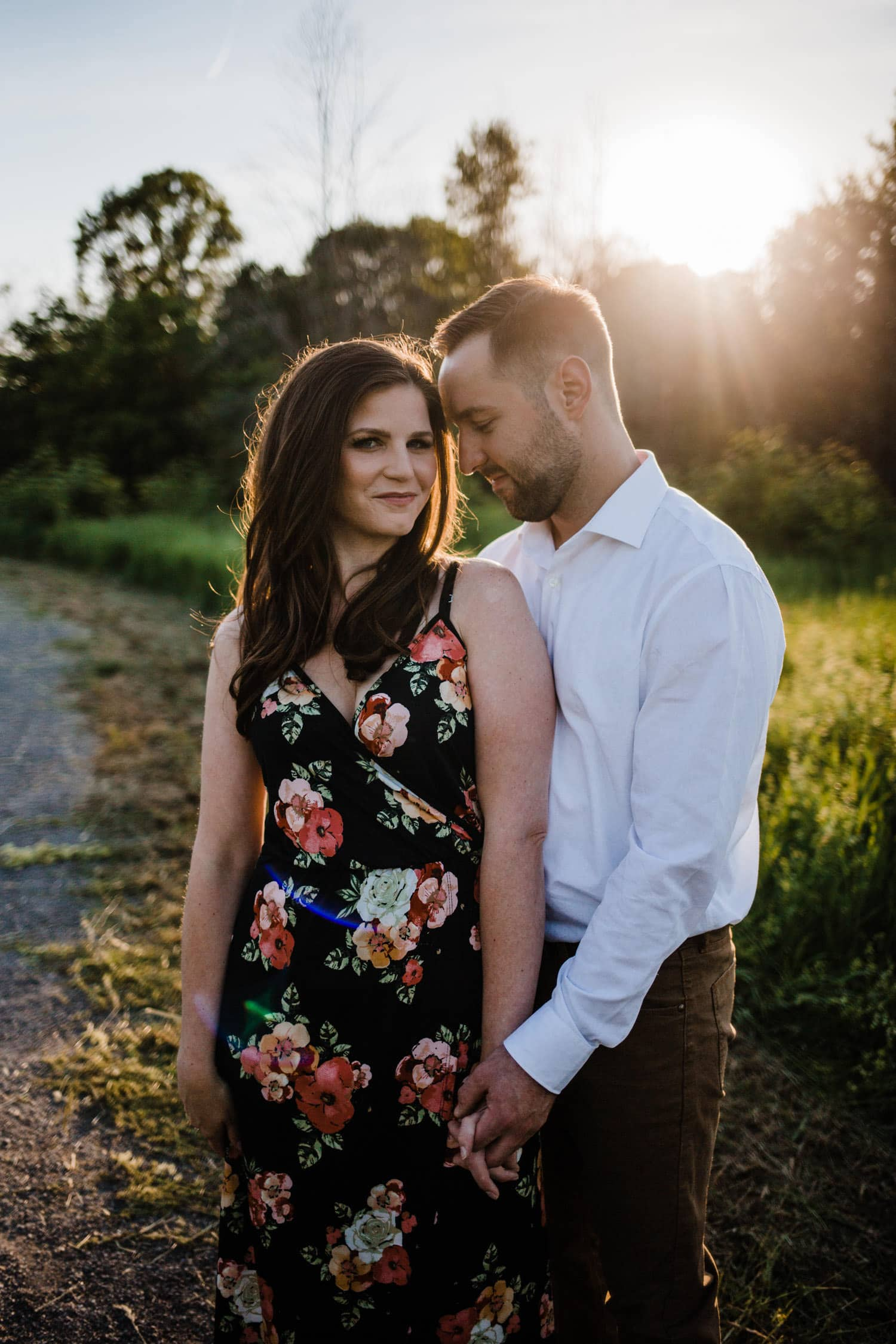 couple hold hands during ottawa golden hour engagement session