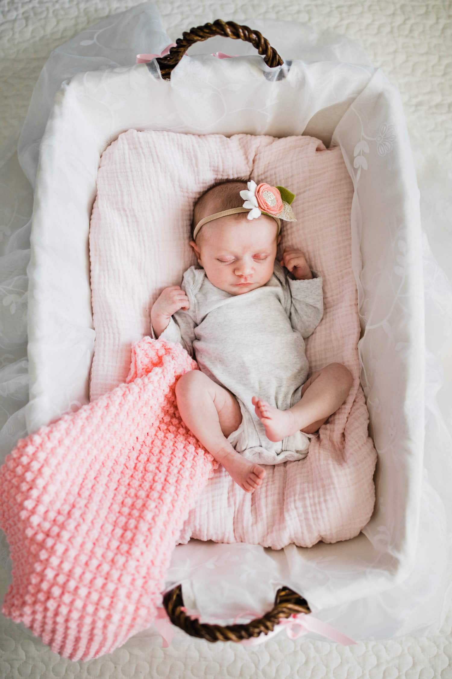 newborn baby in family heirloom basket
