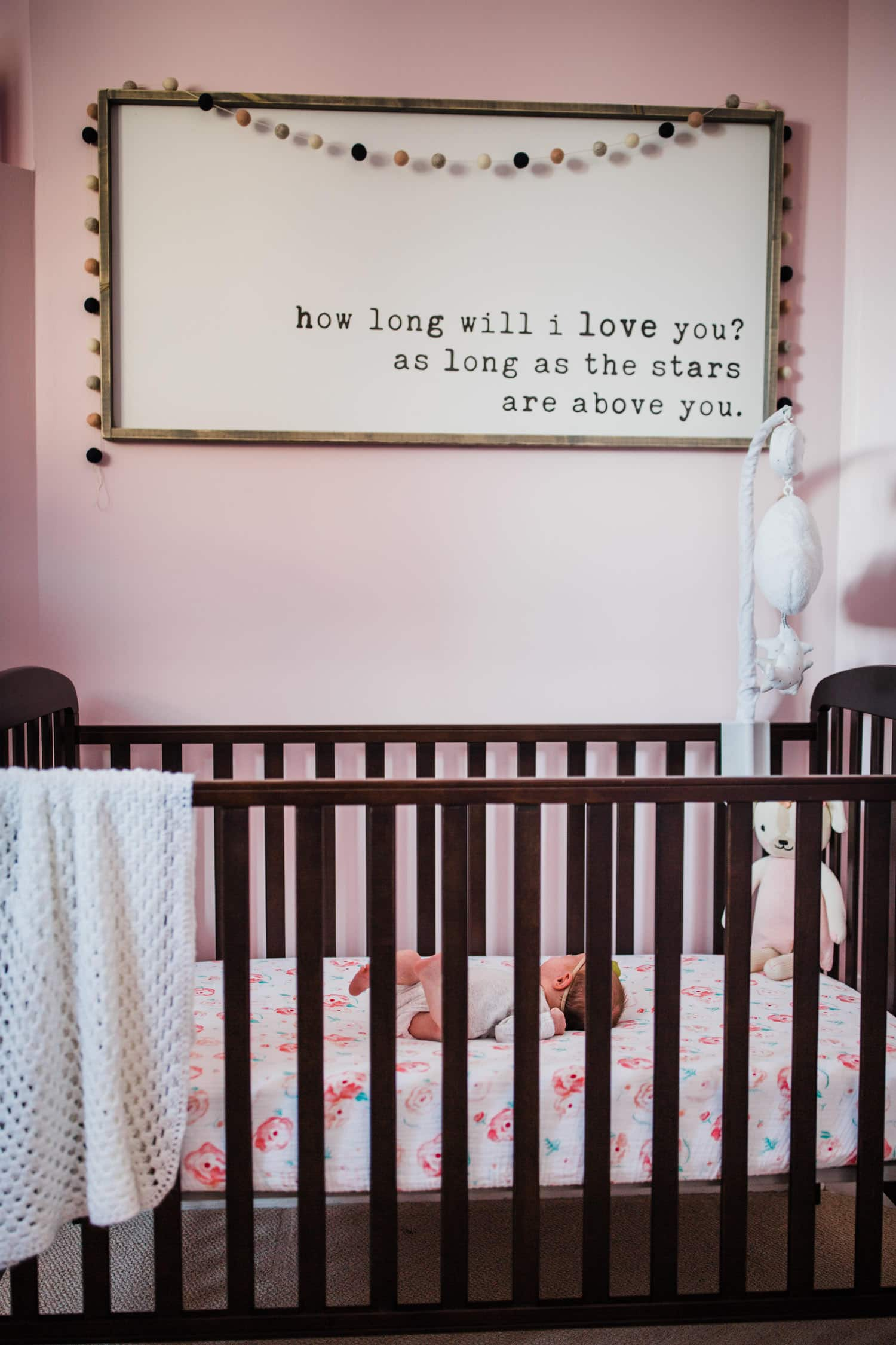 newborn baby in her crib