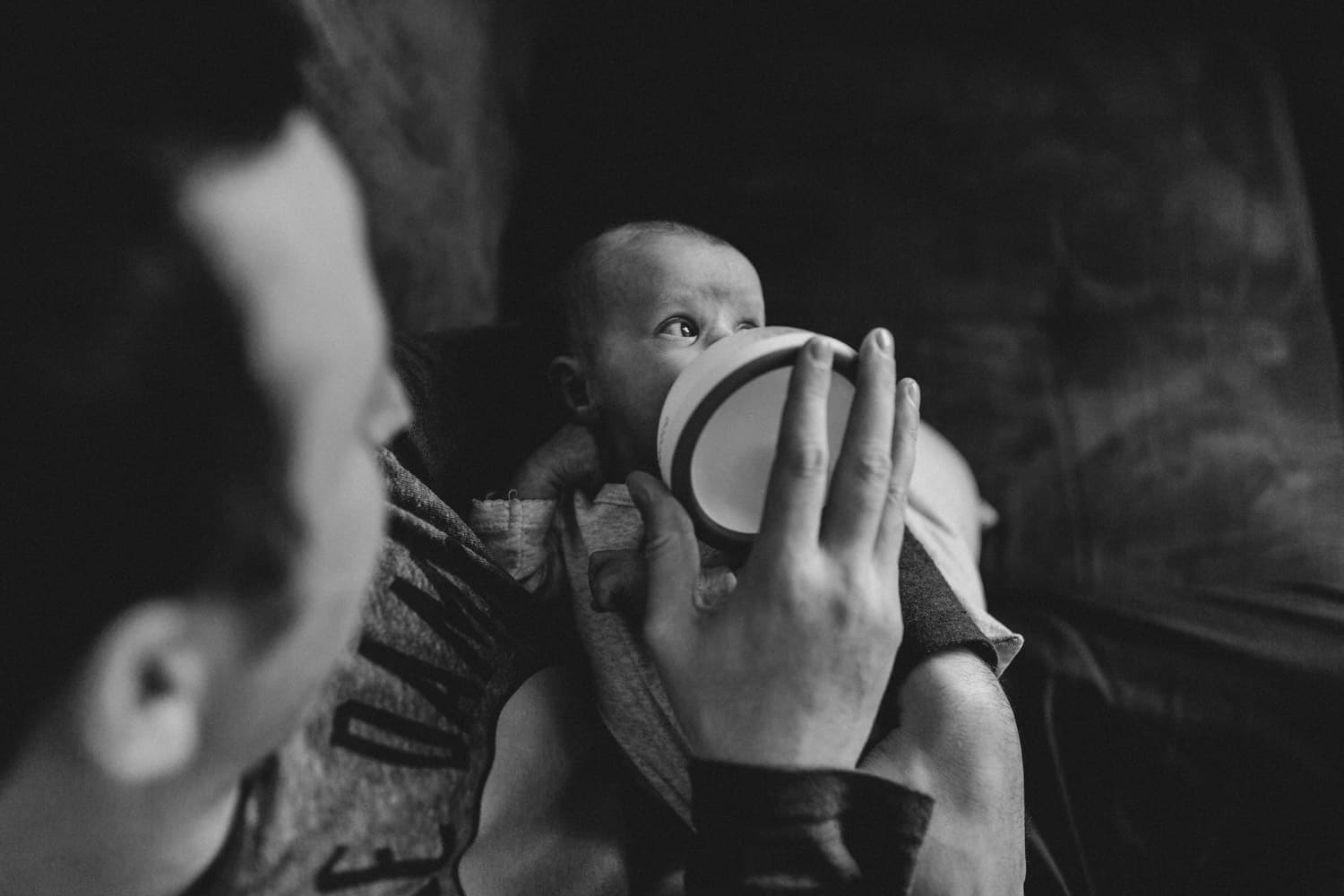 dad bottle feeds new baby - lifestyle newborn session