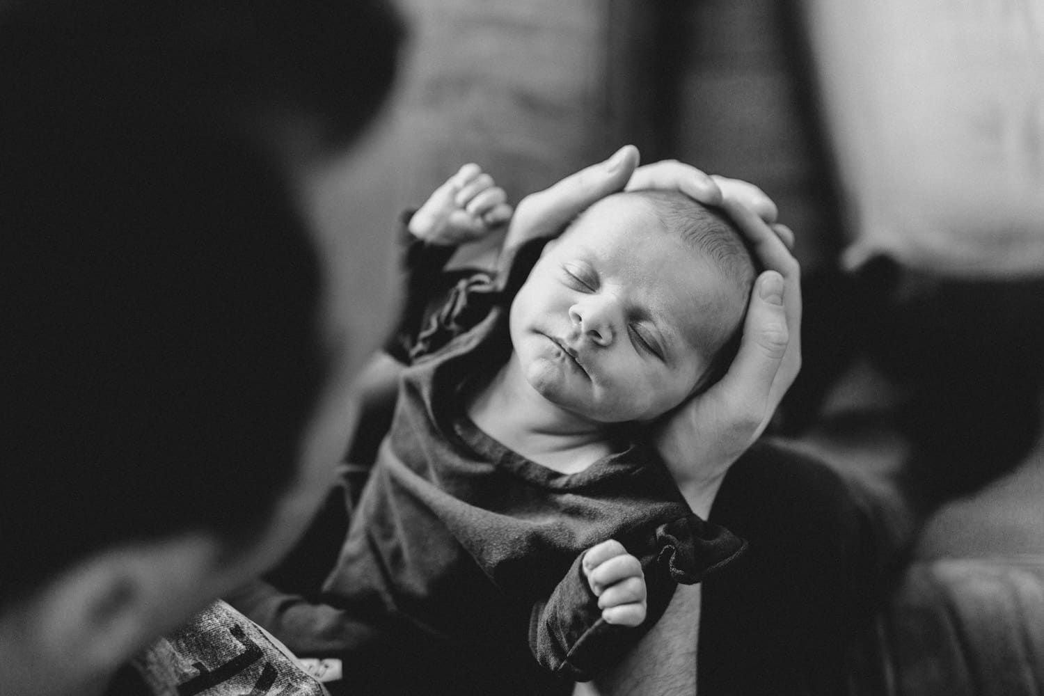 new baby sleeps in dad's arms - lifestyle newborn session