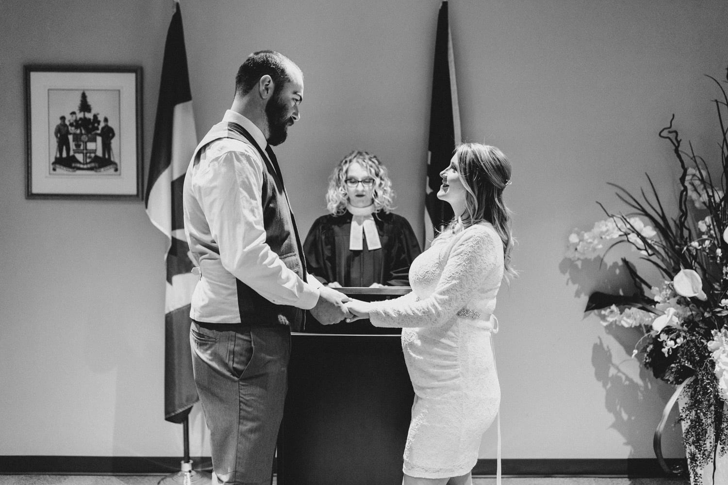bride and groom recite vows at ottawa city hall