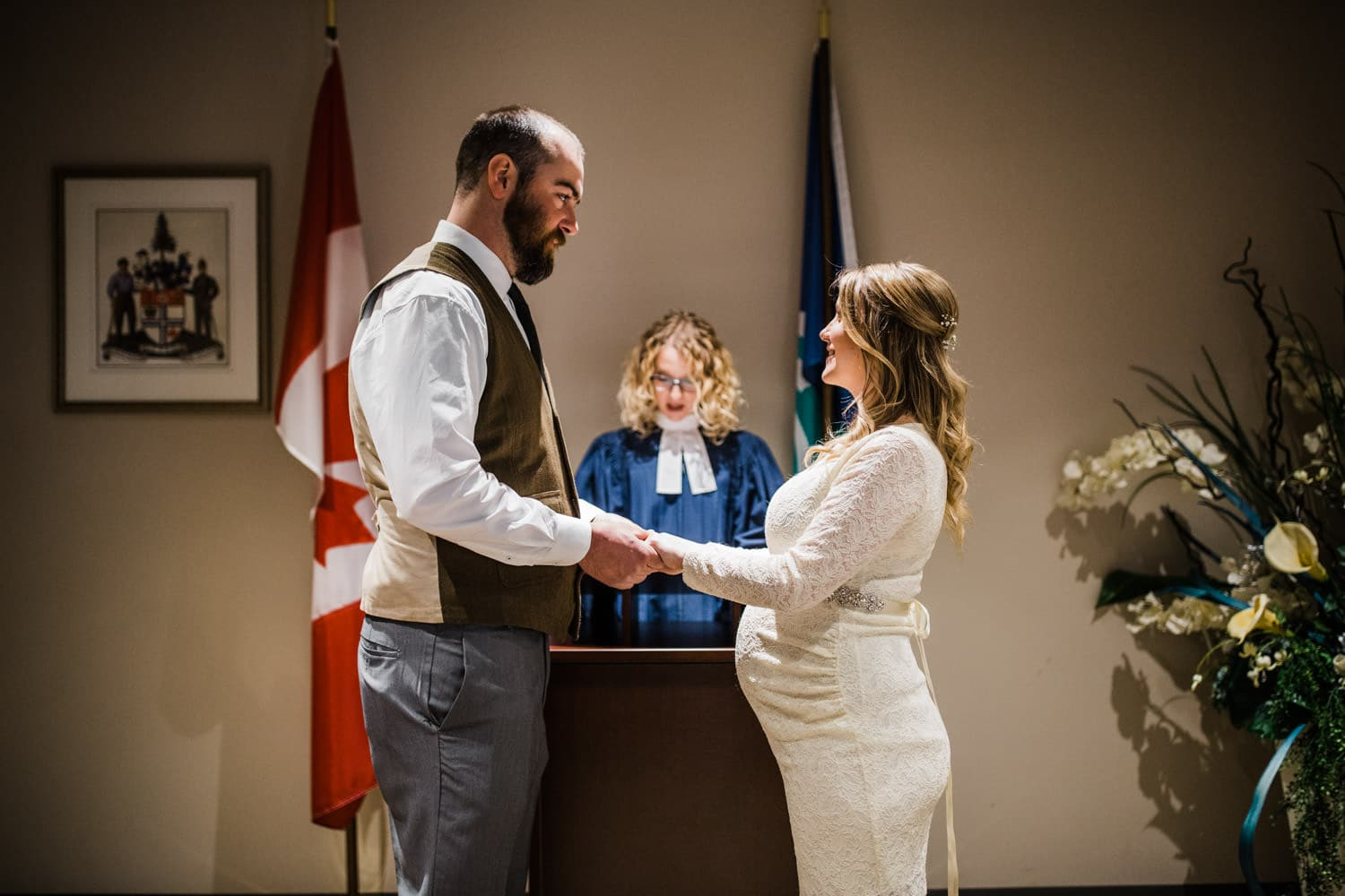 bride and groom exchange vows during ottawa city hall wedding