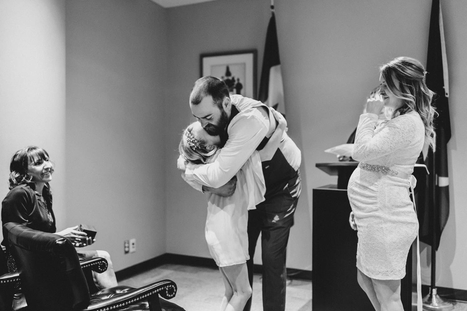 family hugs after wedding ceremony