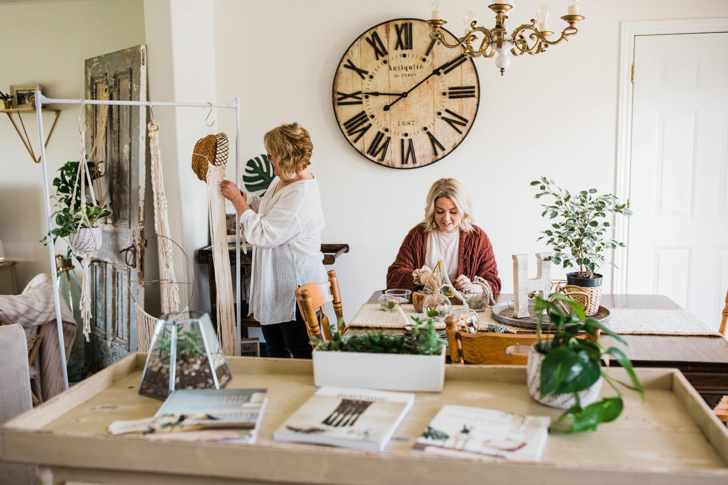 mother and daughter work on plants and macrame products in living room - brand photography ottawa