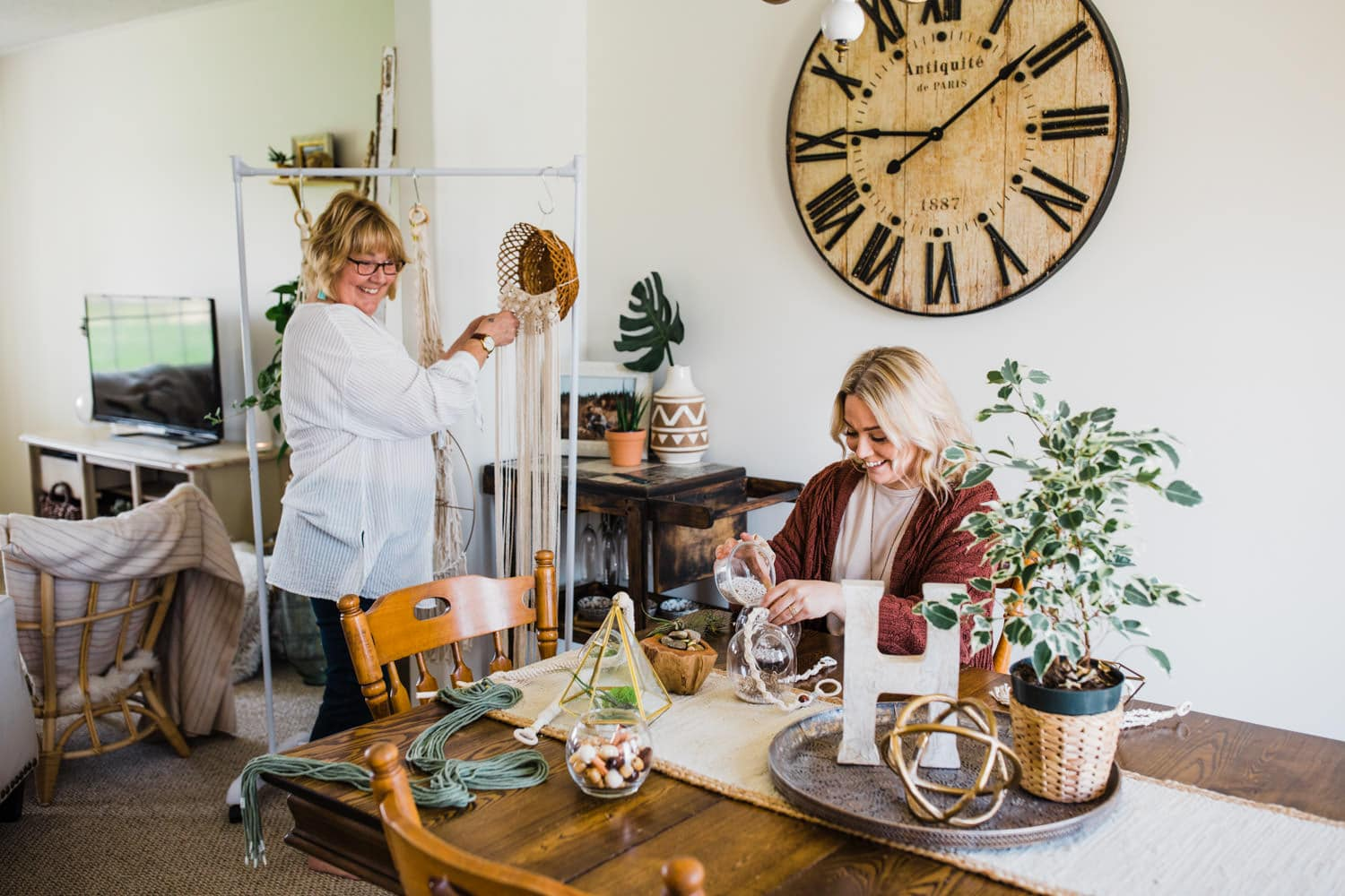 mom and daughter work on plants and macrame - ottawa brand photography