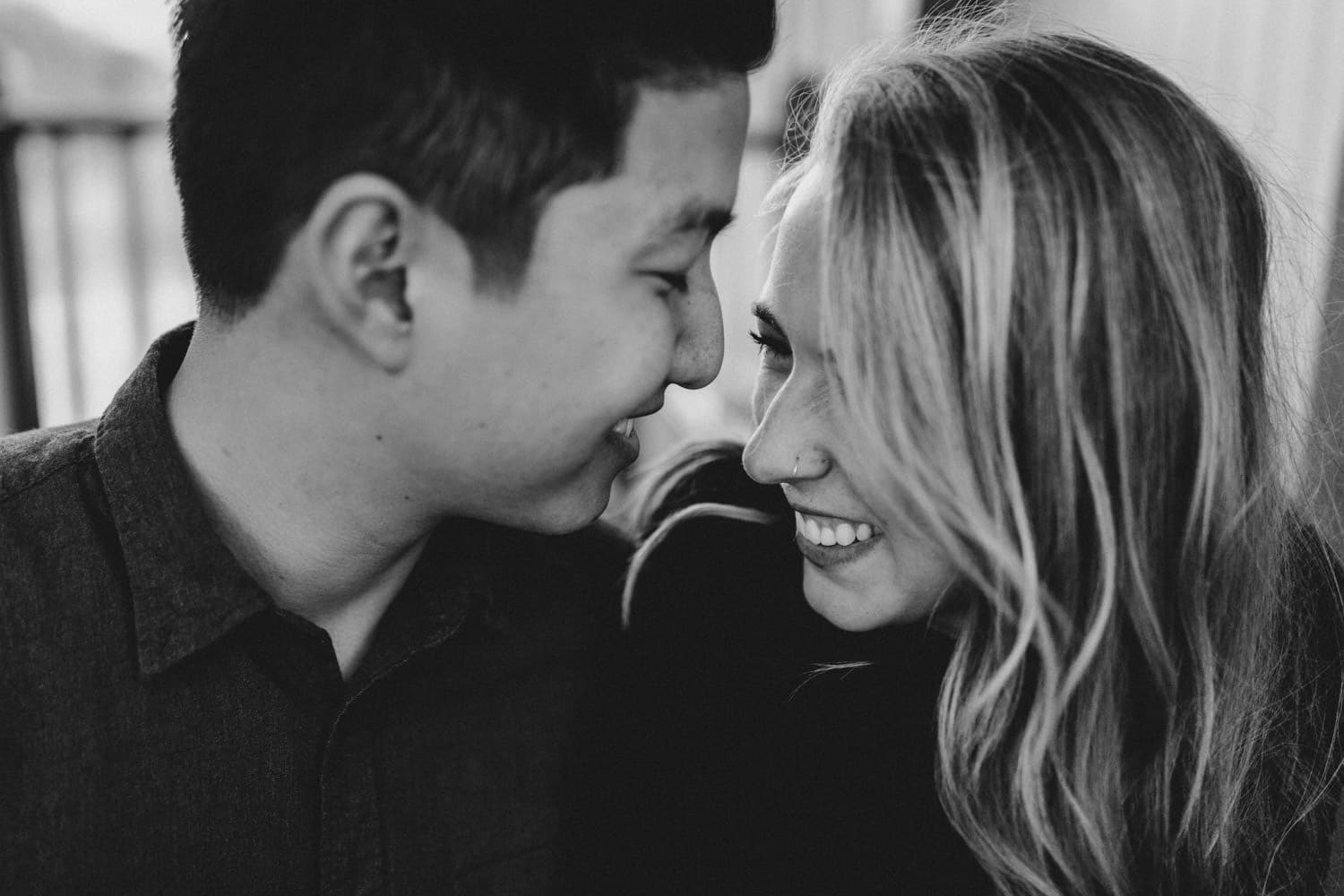 black and white portrait of couple laughing together - ottawa engagement session