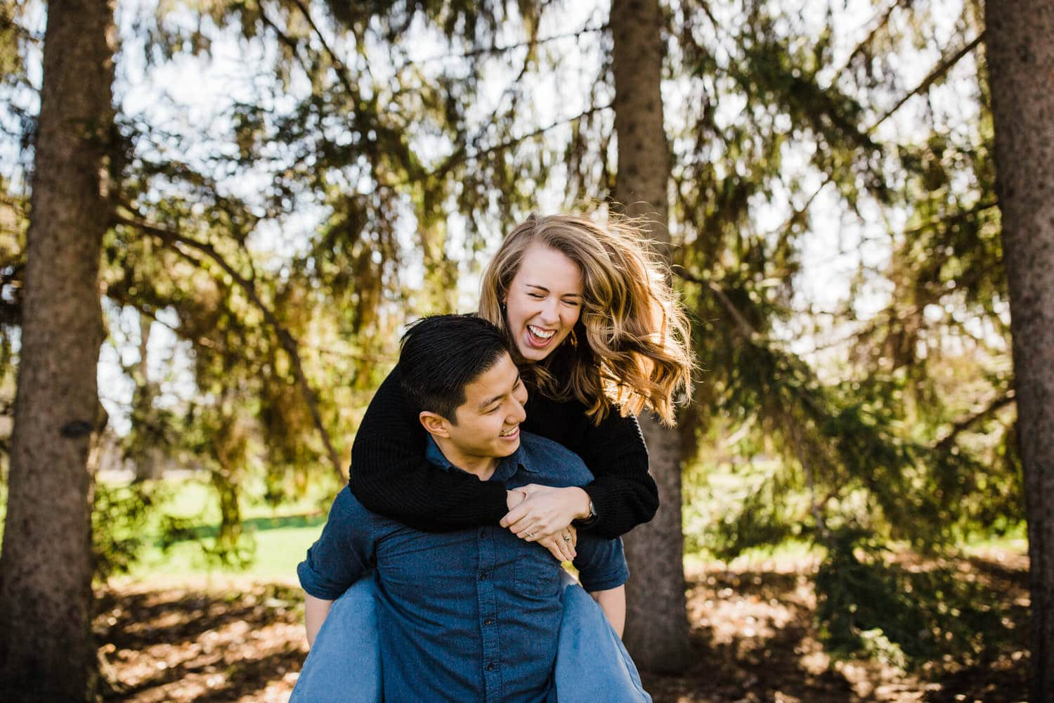 man gives woman a piggy back ride - ottawa engagement session
