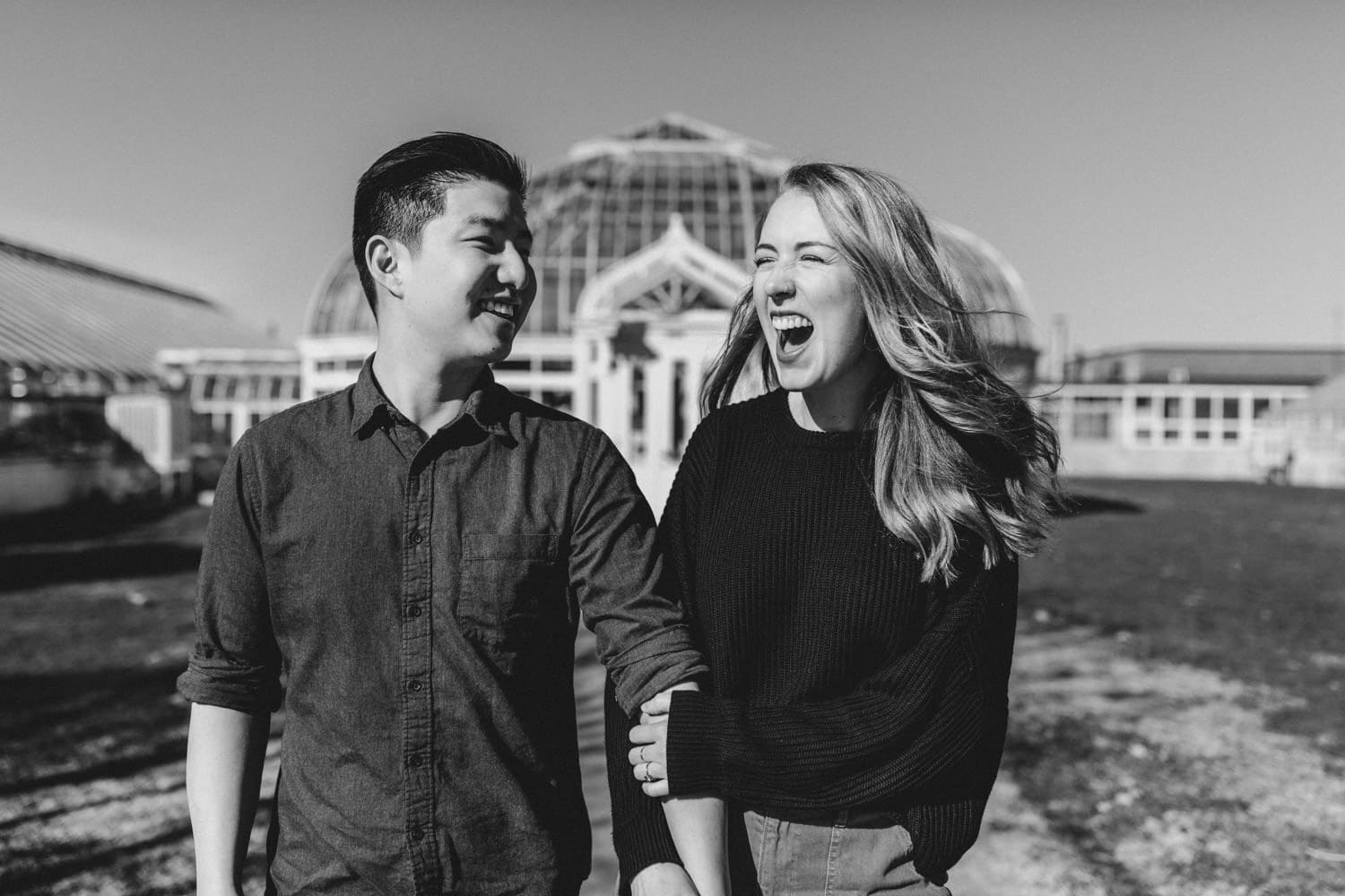couple laugh together at experimental farm greenhouse