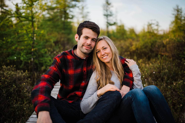 Couple sit together on boardwalk