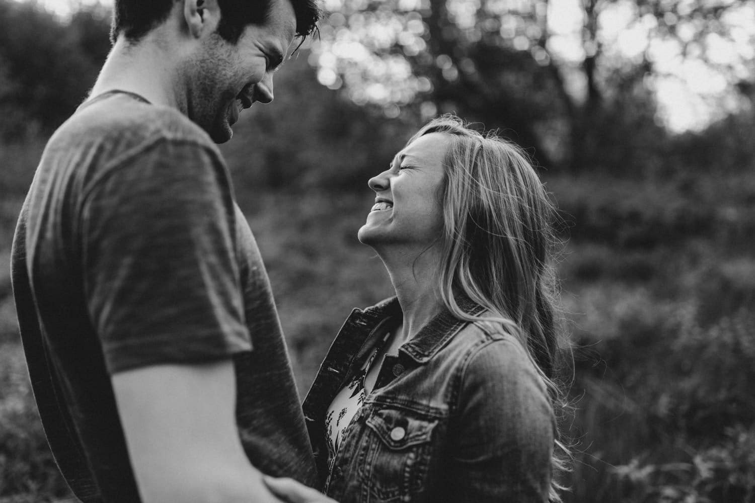 Black and white photo of couple laughing together outside