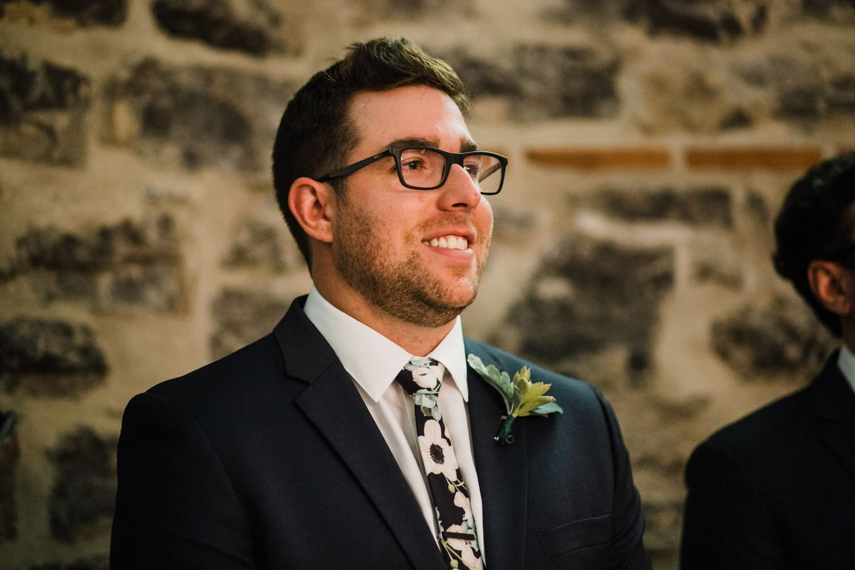 groom sees bride walking down aisle - downtown ottawa wedding - all saints chapel