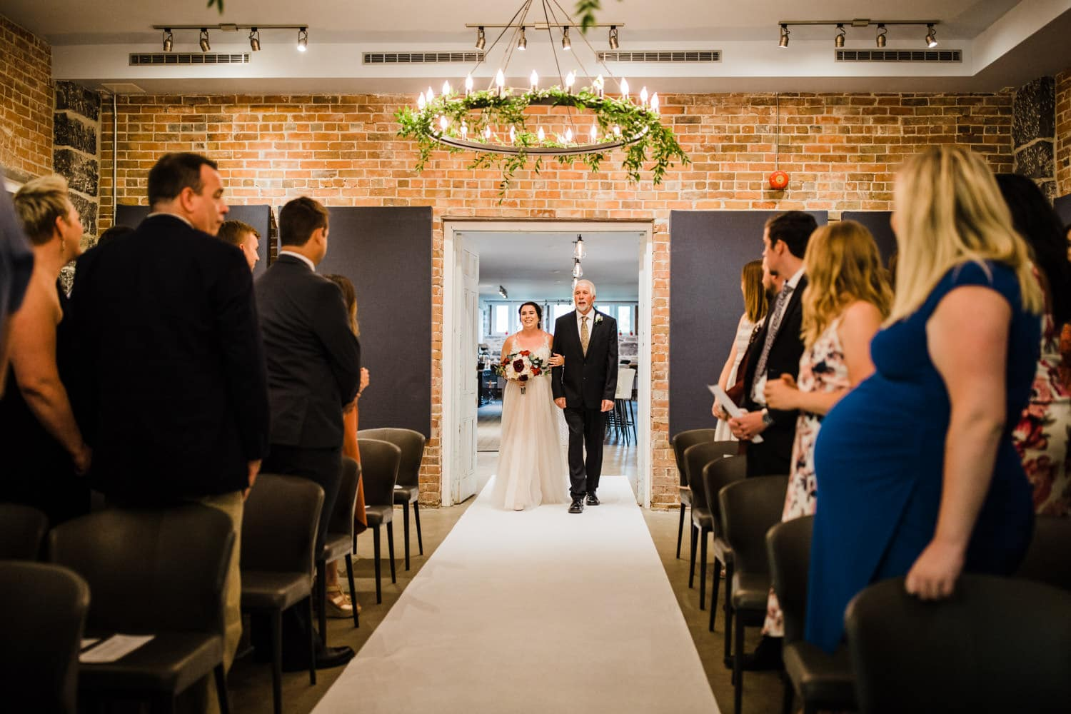 bride walks down the aisle with her father - all saints events chapel