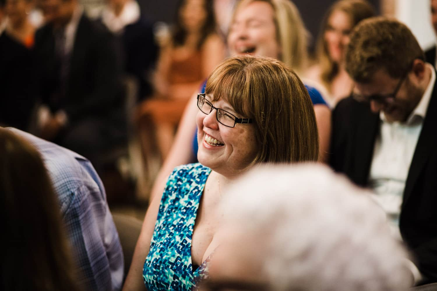 guests laugh during ceremony