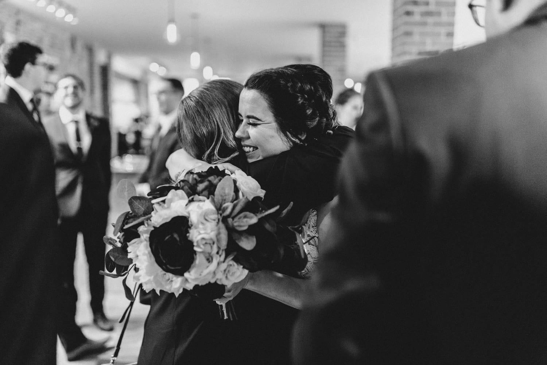 bride hugs mom after ceremony