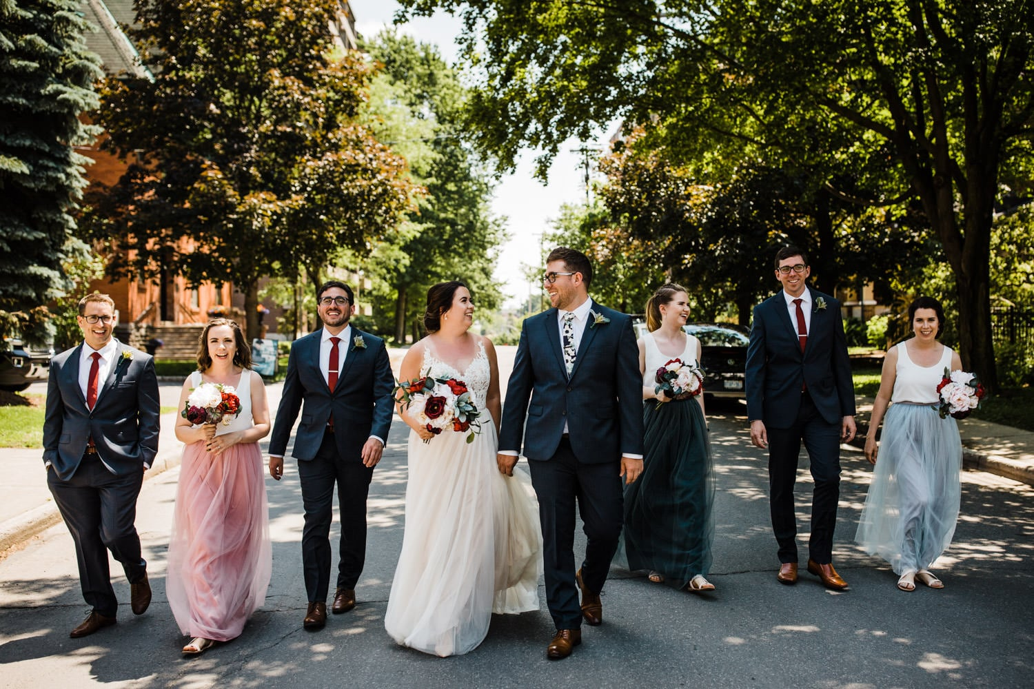 wedding party walks down street - carley teresa photography