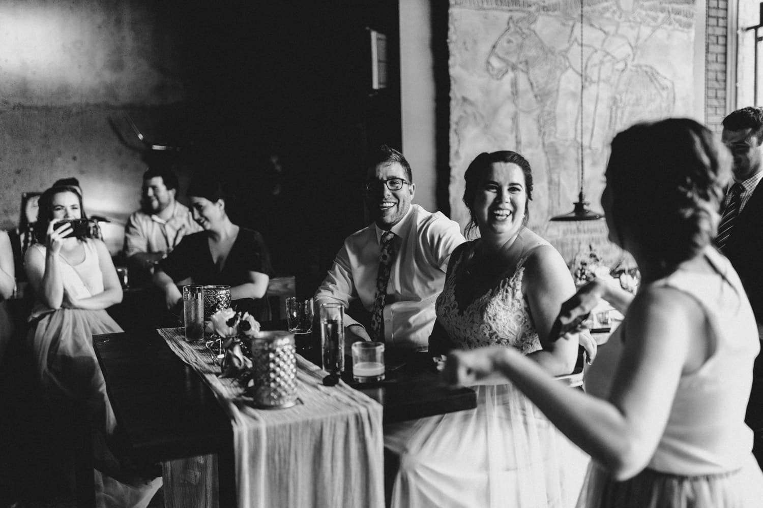 bride and groom react to speeches at el camino wedding